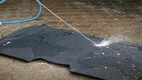 Husky liners being water hosed clean