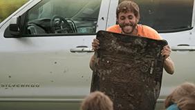 Man holding husky floor liners