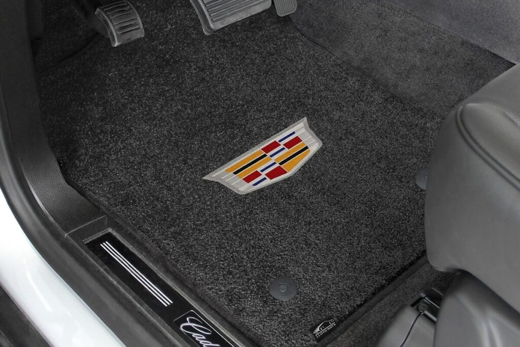 Photo example of carpet floor mats with a Cadillac logo