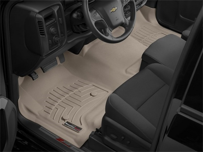 Photo of tan WeatherTech floor liners installed in a truck