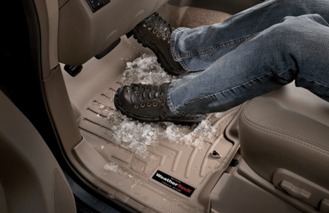 Photo showing feet and snow on a WeatherTech digitalfit floor liner