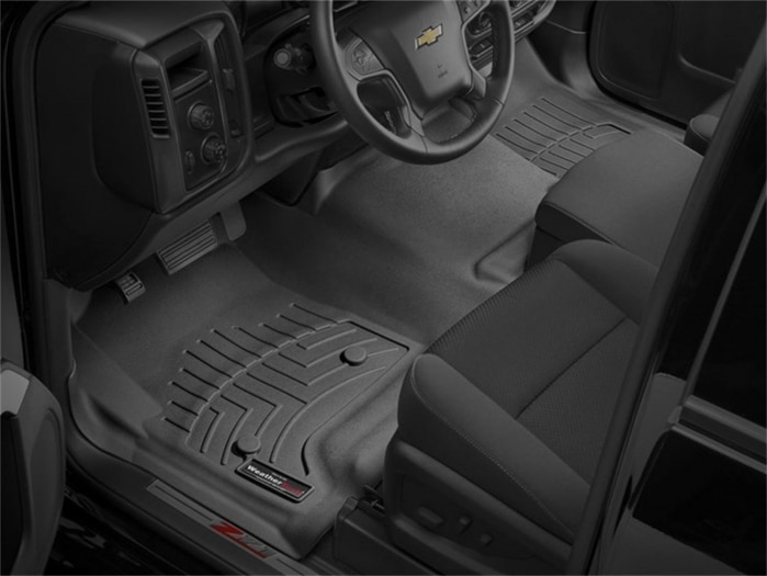 Photos of WeatherTech floor liners installed in a Chevy truck