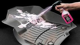 Cleaner spraying on WeatherTech mats