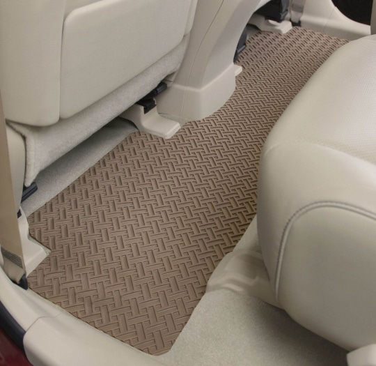Photo of tan NorthRidge floor mats installed in the rear
