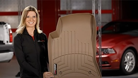 Lady holding a tan WeatherTech liner