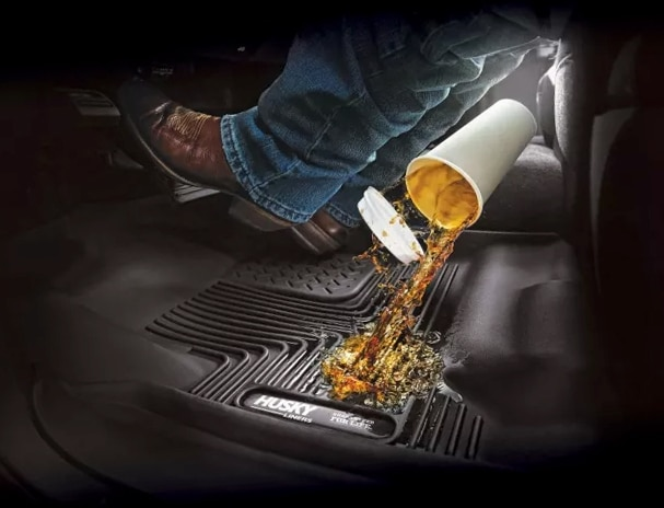 Photo showing a drink being spilled on Husky X-Act floor liners