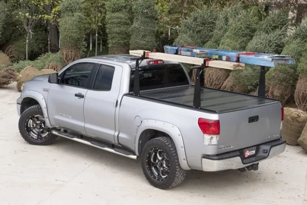 BAKFlip CS installed on a truck with cargo hauled on top of the rack