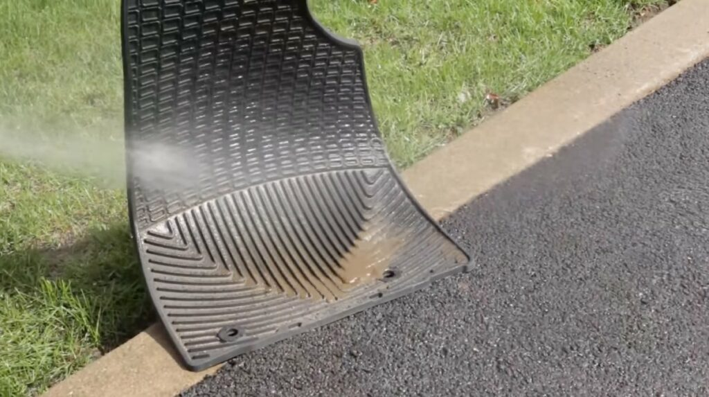 WeatherTech all-weather mat being washed