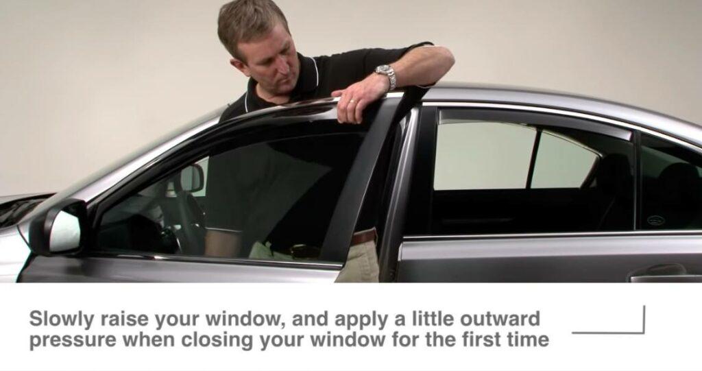 Carefully roll up window
