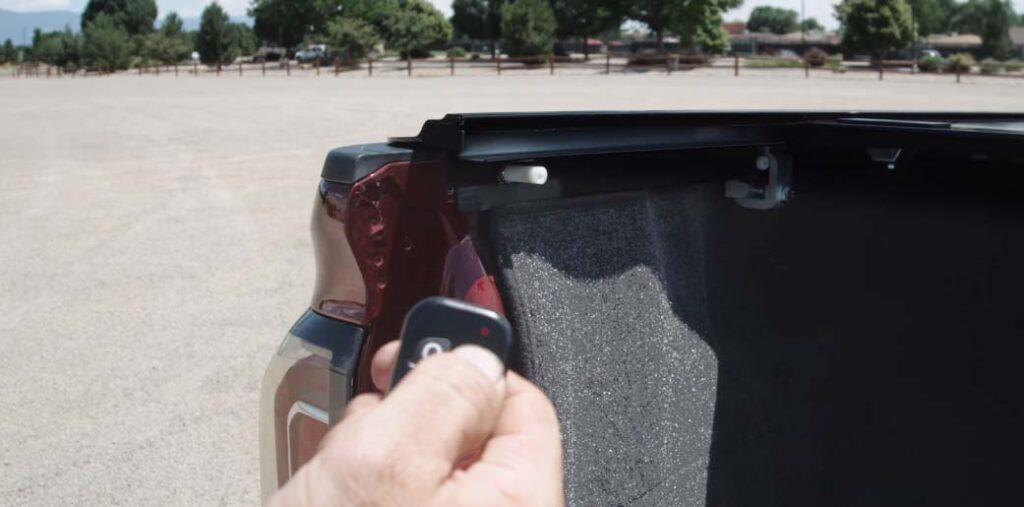 Electric key fob operation of tonneau cover