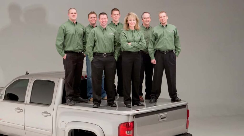 7 people standing on an UnderCover tonneau