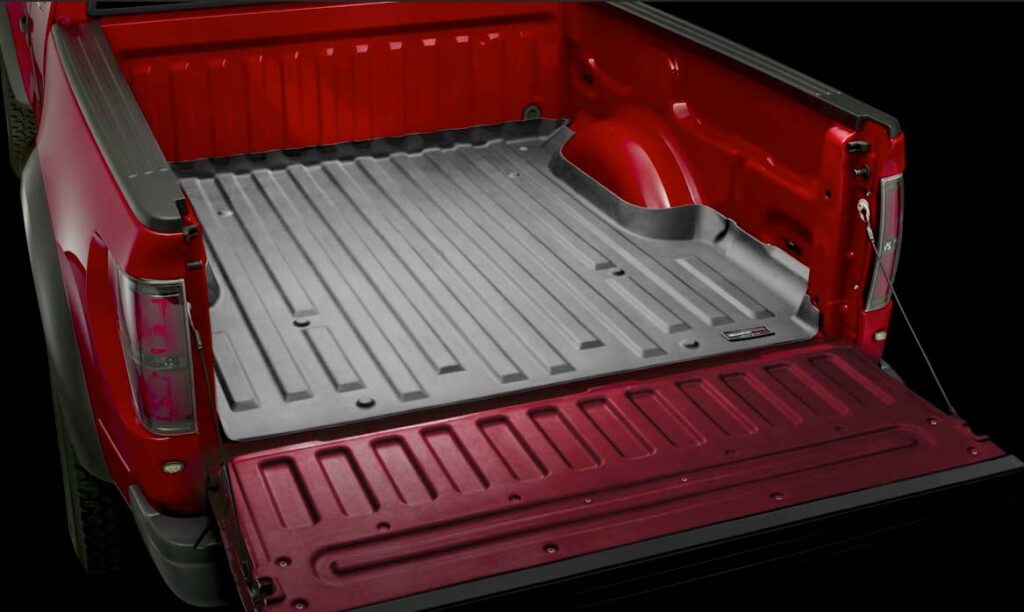 A pickup truck bed installed with black WeatherTech liner