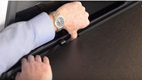 Door latching system on a TruXedo Deuce tonneau cover